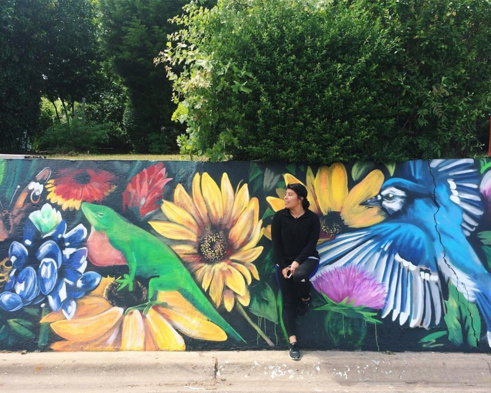@yasmiiiiiin_ in front of one of our favorite murals from Keep Denton Beautiful.