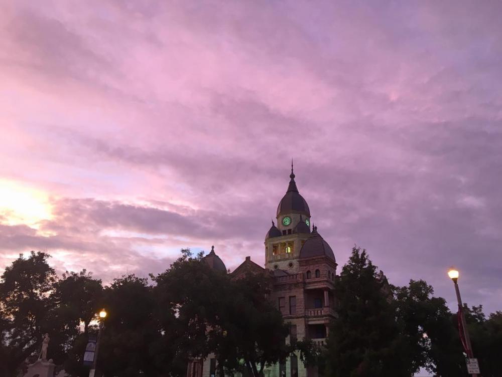@kkendrickbigley shot the courthouse in front of a pink/purple sunset.