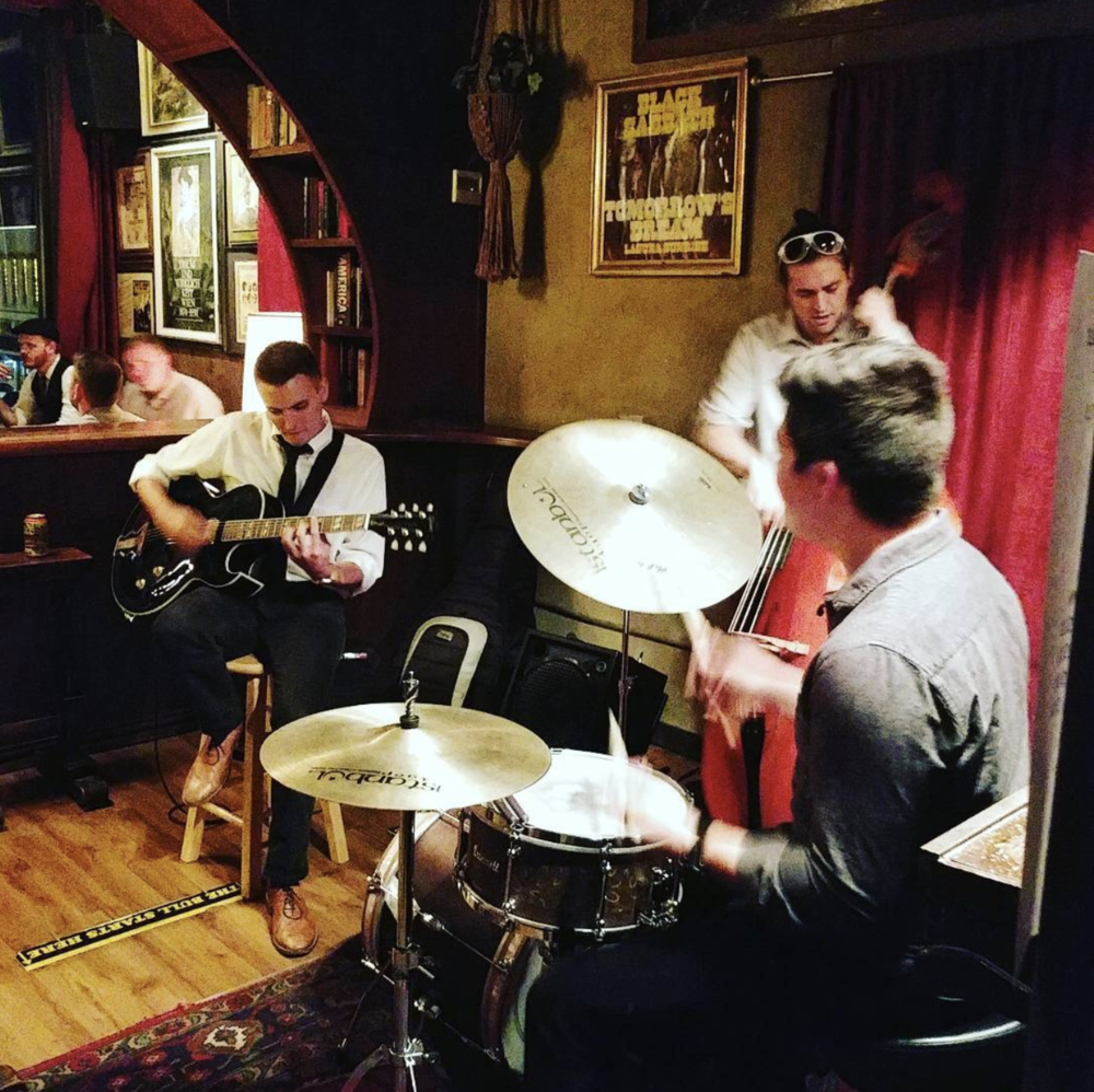 A jazz trio playing at Paschall's birthday party last week. Photo by @thebrainybabe.