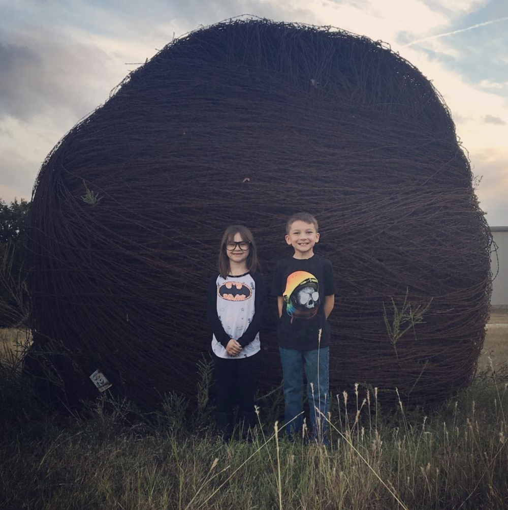 @the_busy_bennetts in front of J.C. Payne's barbed wire collection. Read more about this gigantic ball of barbed wire in our article on   Denton Oddities  .