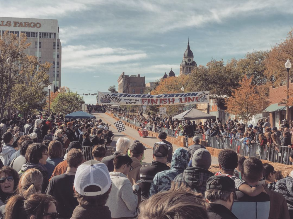 Saturday was both the Coffin Races and the Denton Day of the Dead festival. Here's a photo of the races looking up Hickory St. from @bradfornow. In case you were wondering, yes, all coffins had to back in angle park on Hickory St. when not in use.