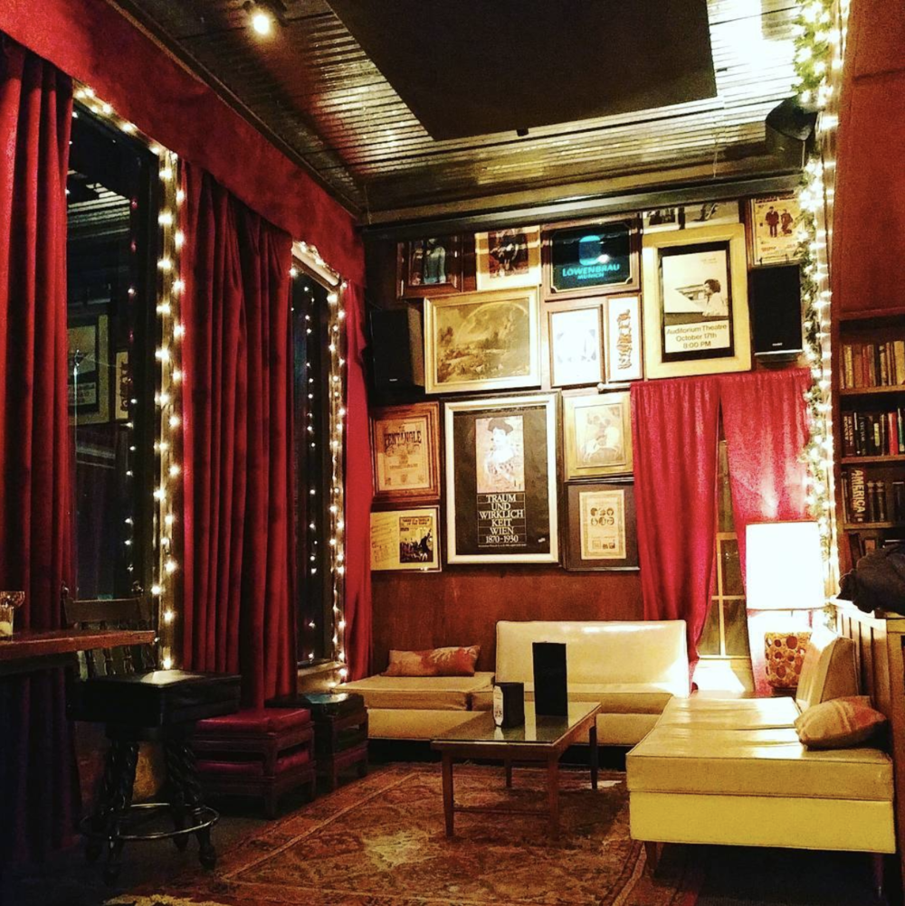 A photo of Paschall Bar decorated for the season by @thebrainybabe.
