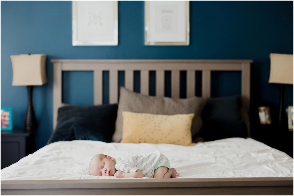 newborn-baby-on-parents-bed