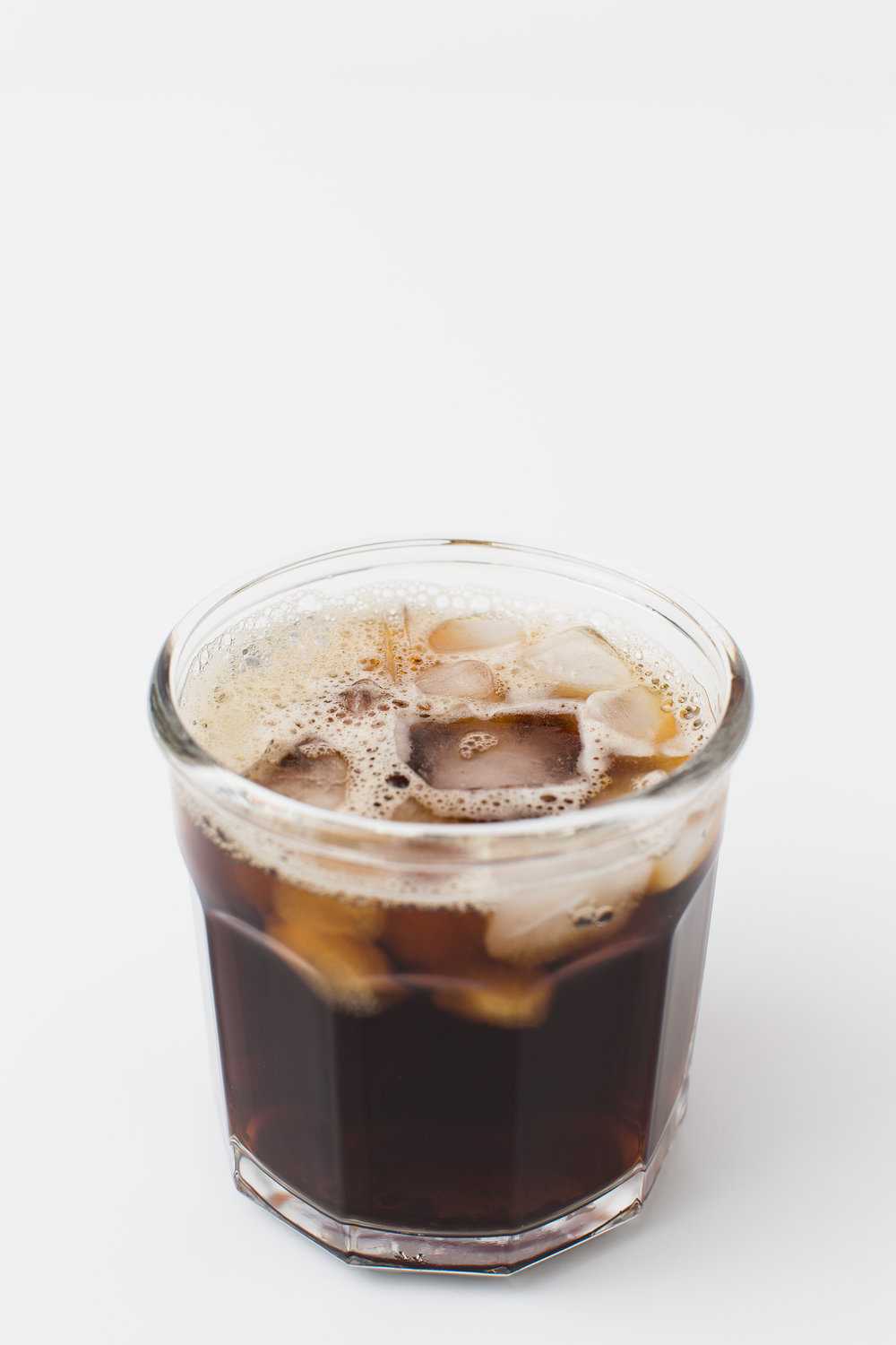 Eote iced coffee with milk clear glass social media marketing photography
