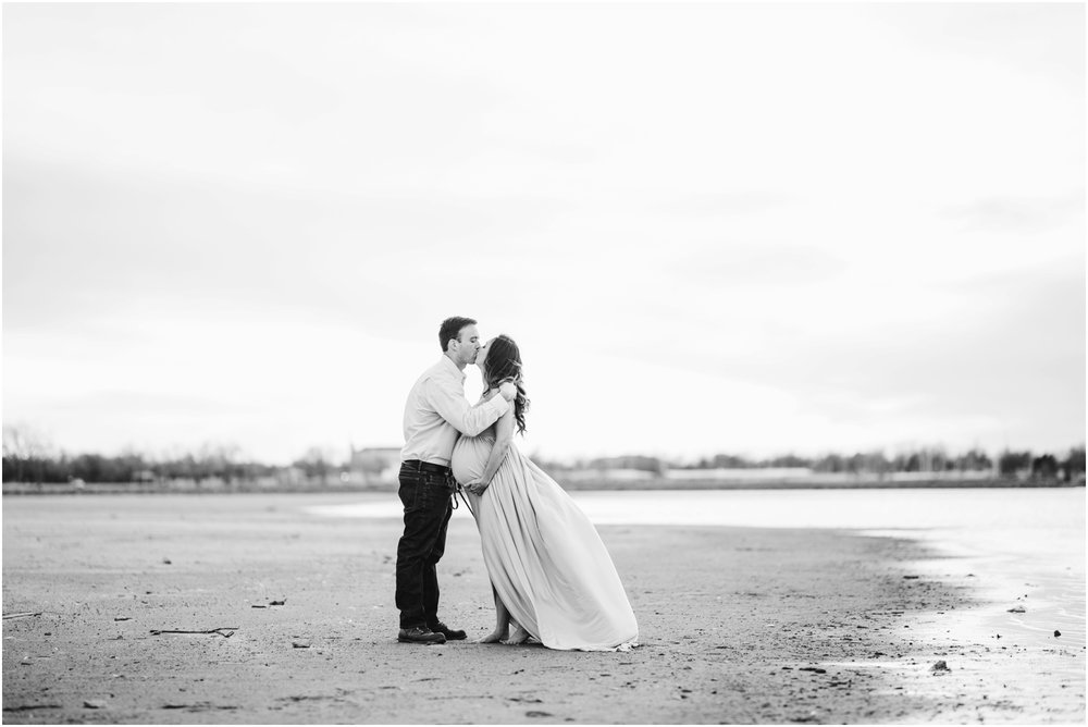 black and white beach portraits with expecting parents