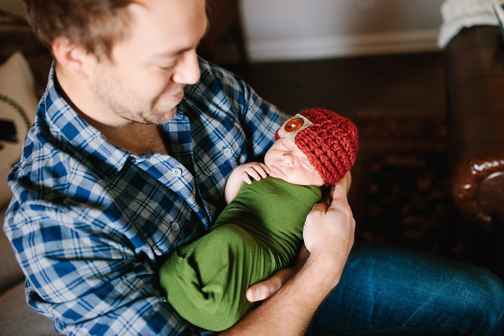 mustang-oklahoma-family-lifestyle-photographer-baby-dad-swaddle.jpg
