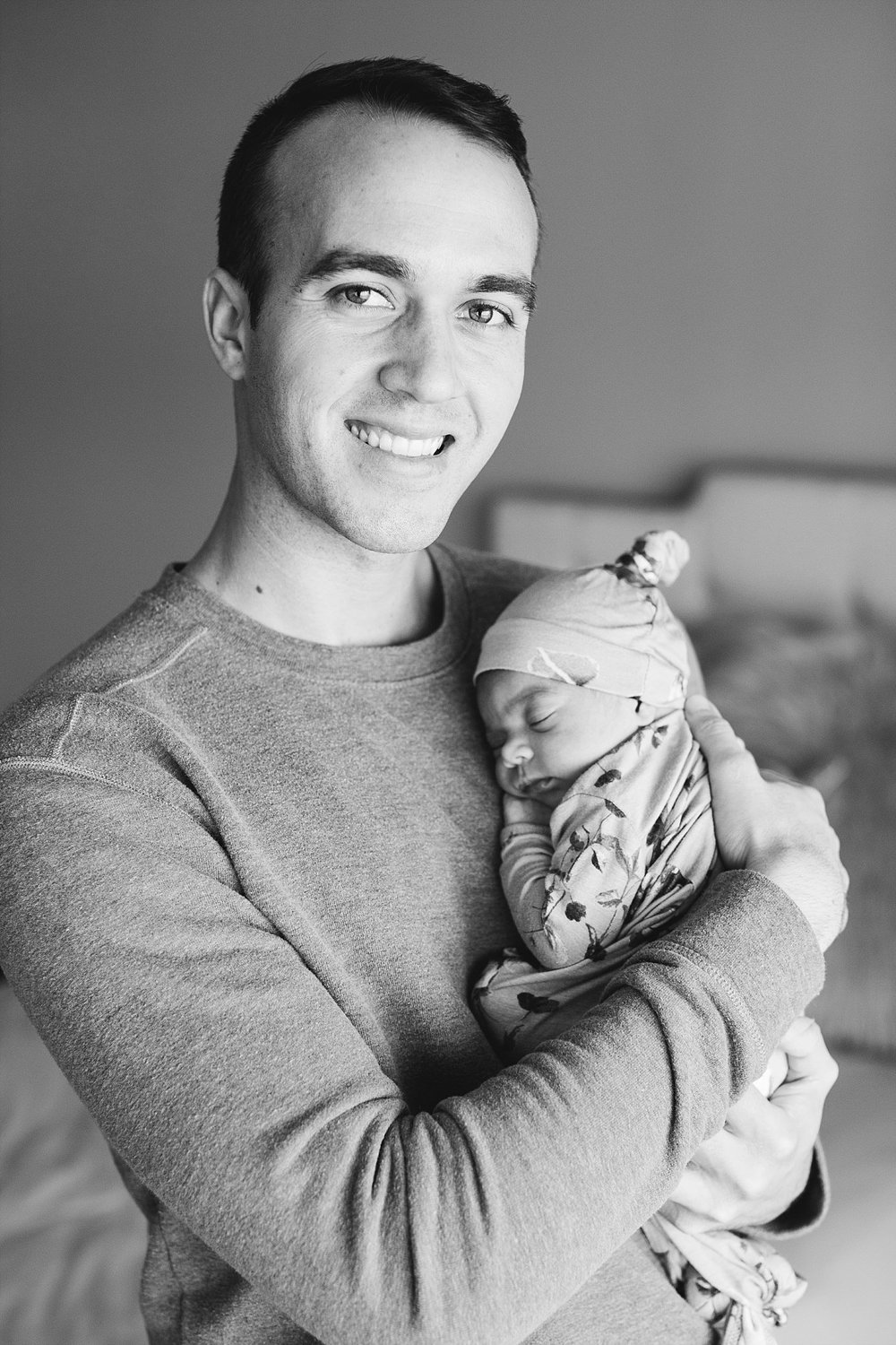 oklahoma-city-photographers-newborn-studio-dad-baby-black-white.jpg
