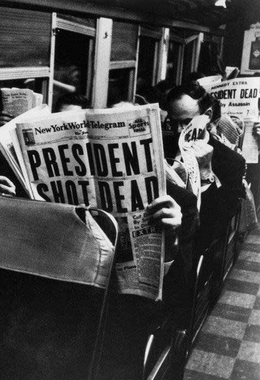 New York Commuters read of John F. Kennedy's assassination. November 1963.