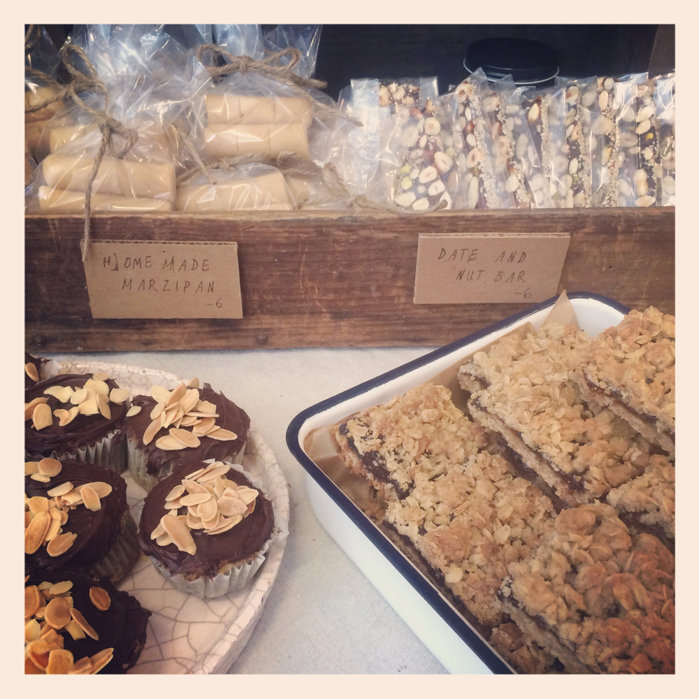 Marzipan and date&nut roll in the back with the tanzeya oat bar and cupcakes in the front