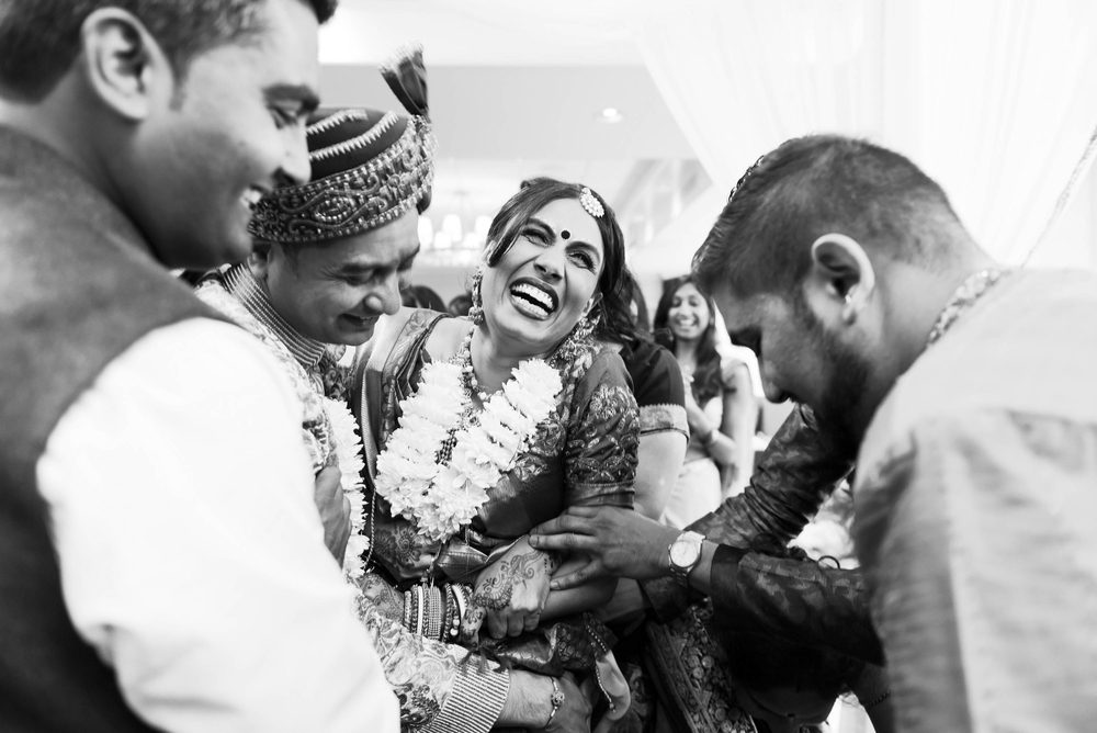 Indian bride and groom during the pehras; a vibrant indoor indian wedding.