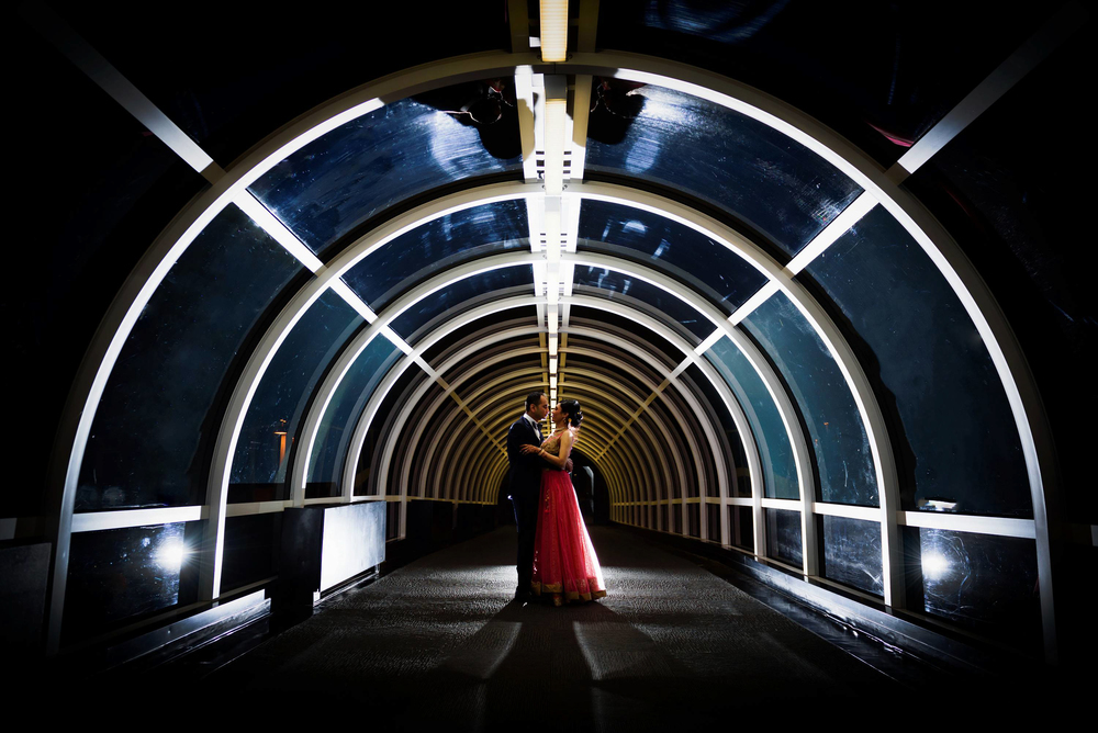 Night wedding photography. Time permitting we always take our bride and groom to create something out of the ordinary. We used the small tunnel at the sheraton hotel for a creative shot of the coupele