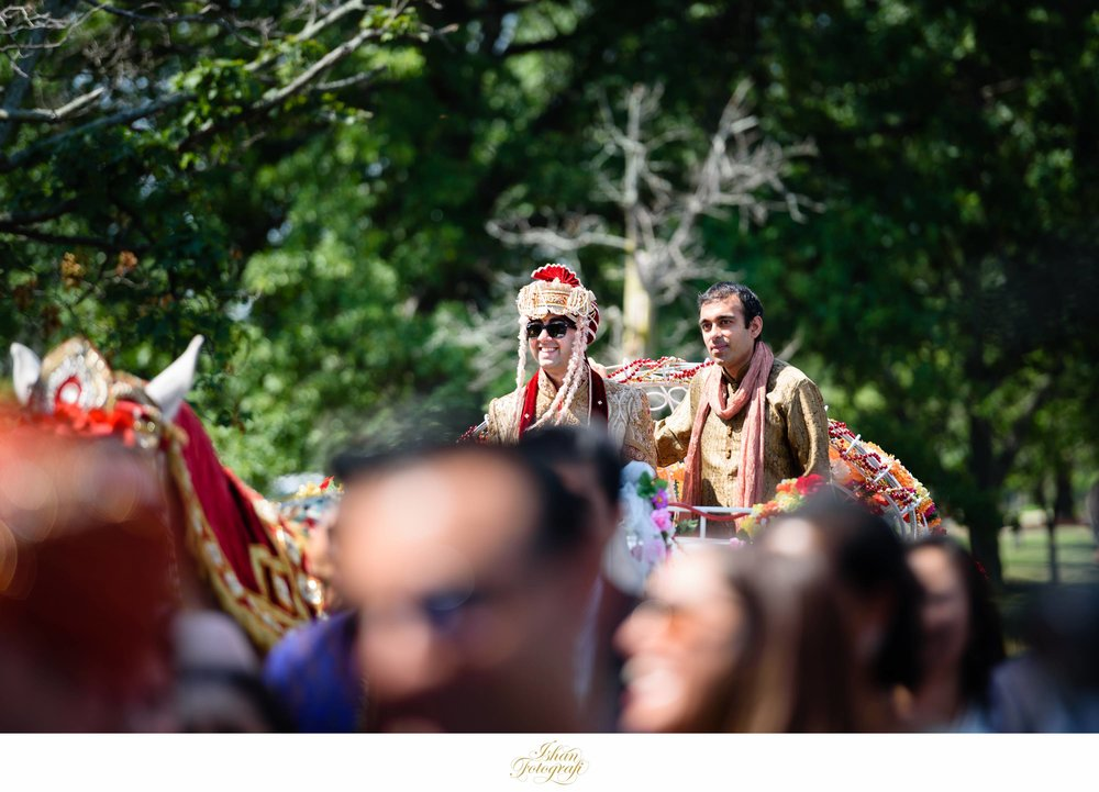 our groom arriving to the bride during the baraat ceremony on a horse.