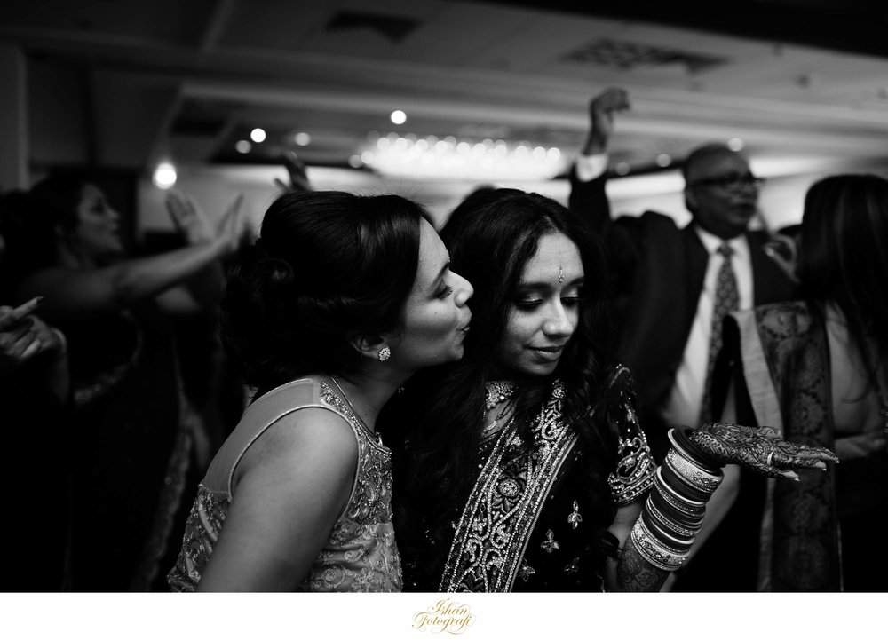 Bride and family friend dancing during reception at an indian wedding at the Nanina's In The Park.