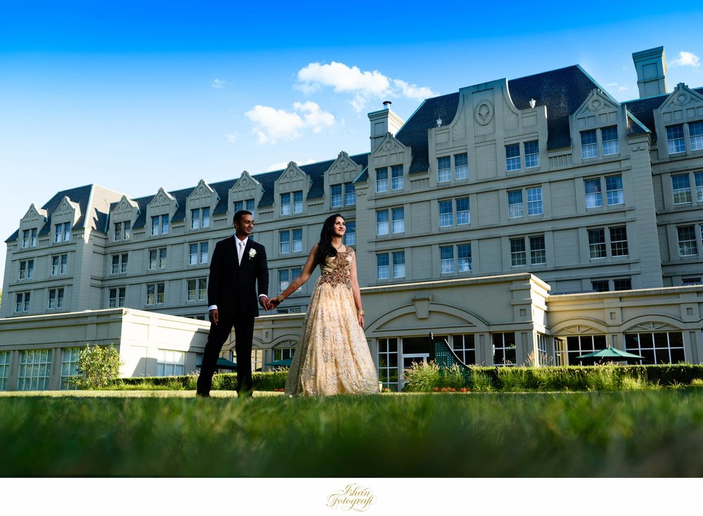 The stunning architecture of hilton hotel. We wanted to encompass the structure and making a stunning photograph of our newly weds.