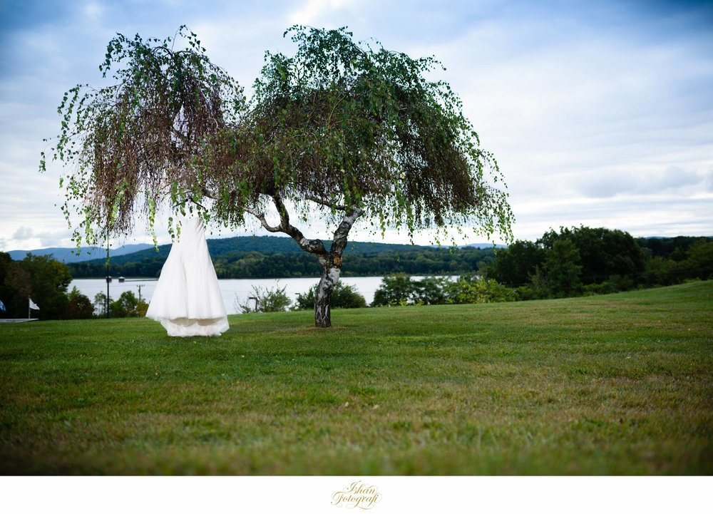 When we arrived at Kerrie's hotel we noticed this tree overlooking the hills and the Hudson river. The bridesmaids were ecstatic when they saw us photographing the dress hanging off of the tree. We are of course, extra cautious handling the dress during shots like these!