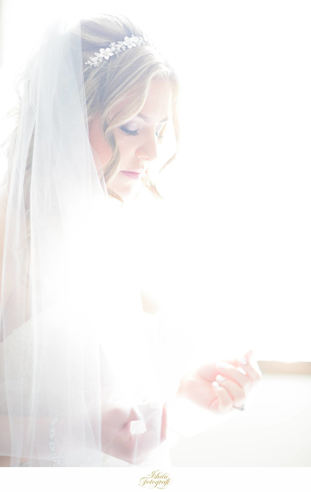 Being able to create a variety of photographs using the same light is something we strive to achieve with each wedding we photograph. We used the morning light pouring through the window to create a stunning bright and airy photograph and then using the same light we created some very moody and dramatic shots.