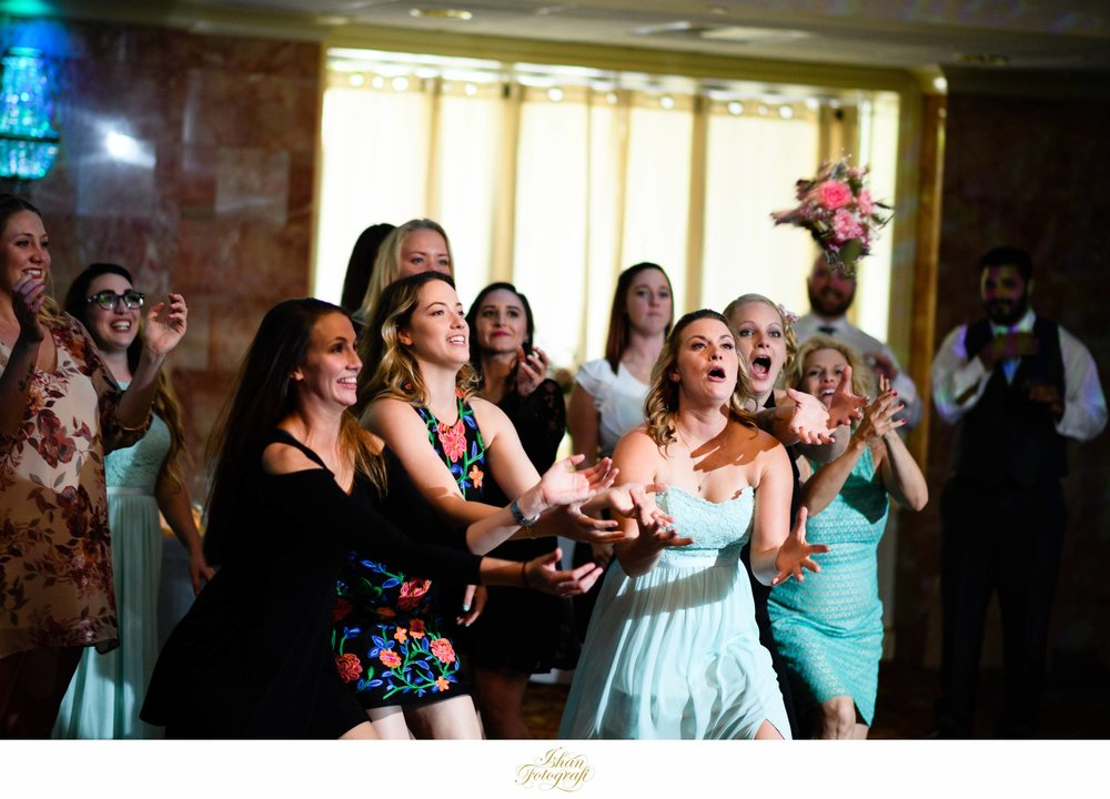 Many trends for wedding day tend to fade in and out; one of those is bouquet toss. We see less of it each year. We never mind photographing such moments and actually enjoy photographing it! Look at those expressions!