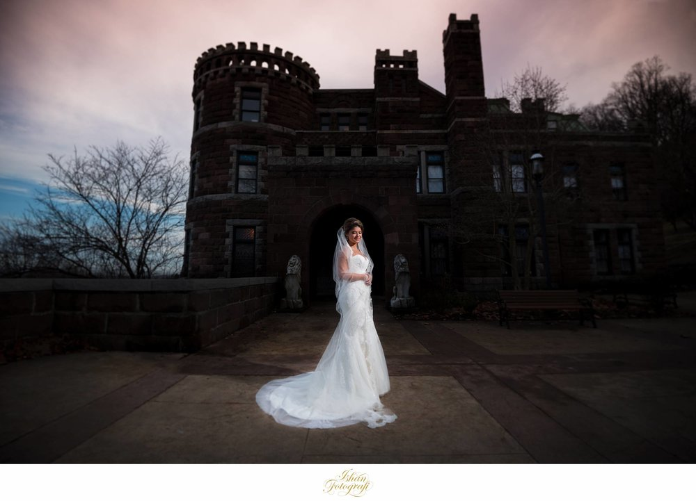 Any professional wedding photographer should be able to deal with changing lighting scenarios and still be able to produce stunning imagery. Although we were literally trying to beat the rain, we wanted to capture the castle, the dark yet dramatic clouds and of course our stunning bride creatively. We love photographing with natural lighting but it has its own limitations and having a strong knowledge and experience of creating your own light when needed helps tremendously to capture great photographs. We used our Profoto B2 lighting system which is very versatile & quick to setup; being able to work rapidly & produce great wedding photos is paramount with wedding photography.