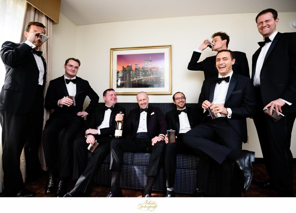 The groom and his groomsmen having a little fun before the wedding reception. These guys were so much fun to photograph on the wedding day! The expression on everyone's face especially our groom is priceless!