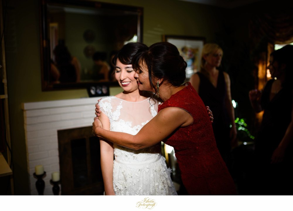The mother of the bride with our gorgeous bride. This was such a loving moment between the two and we are so glad to have captured it! The bride was getting ready to take some photographs with her bridal party and put the veil on when this occurred. We love documenting such genuine moments on a wedding day. They also happen in a flash of the moment so keeping an eye out as a NJ wedding photographer always pays off!