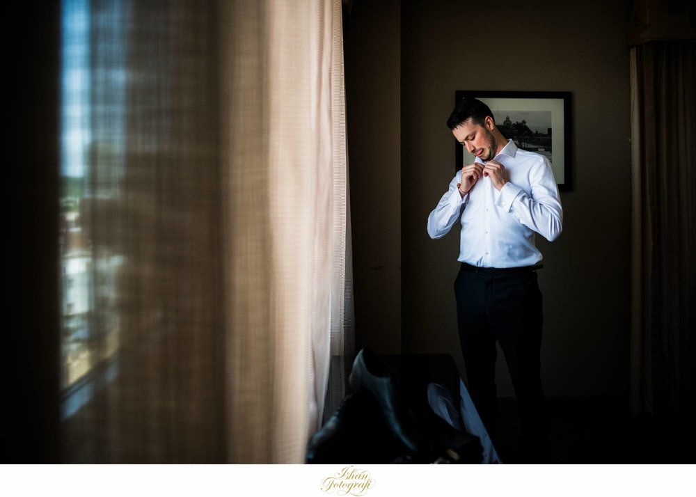 groom-getting-ready-the-heldrich-hotel