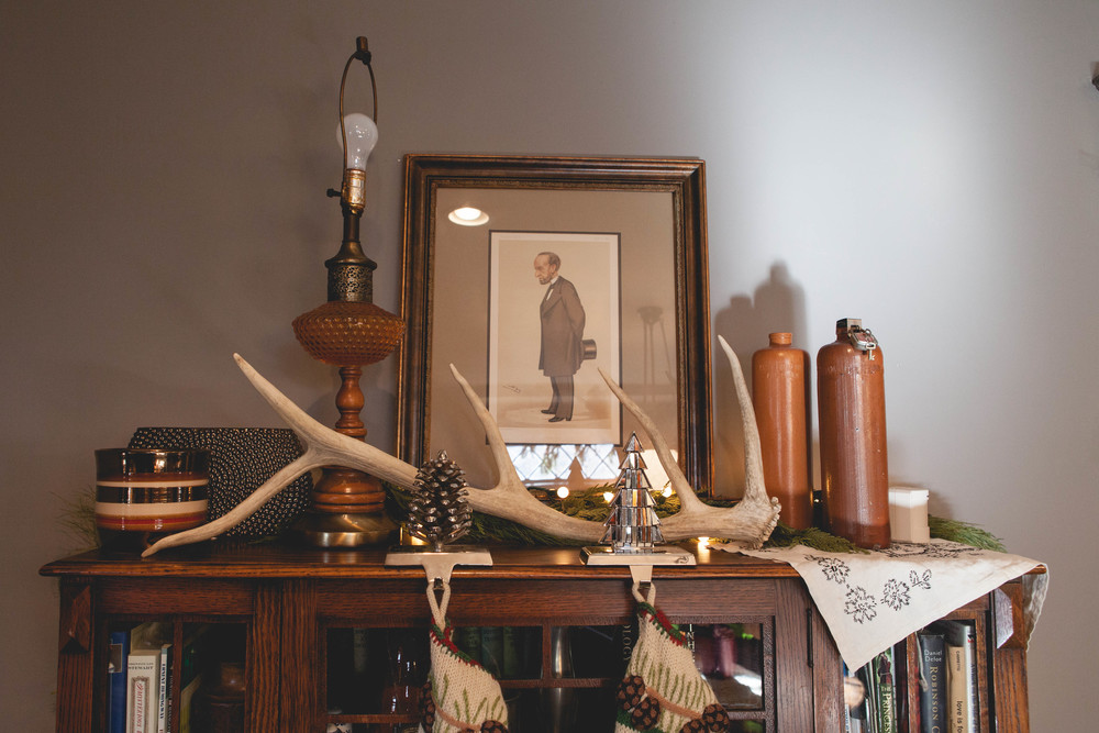 In the living room and dining room, we have several Vanity Fair prints hanging. My mom has always been a collector of these prints, and over the years, she's gifted a handful to us! That's an elk antler that my sister's neighbor was so kind to give me!