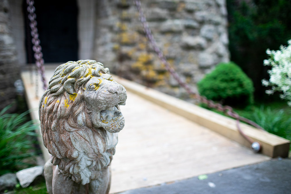 A statue of a lion guards the drawbridge to the Hammond Castle.
