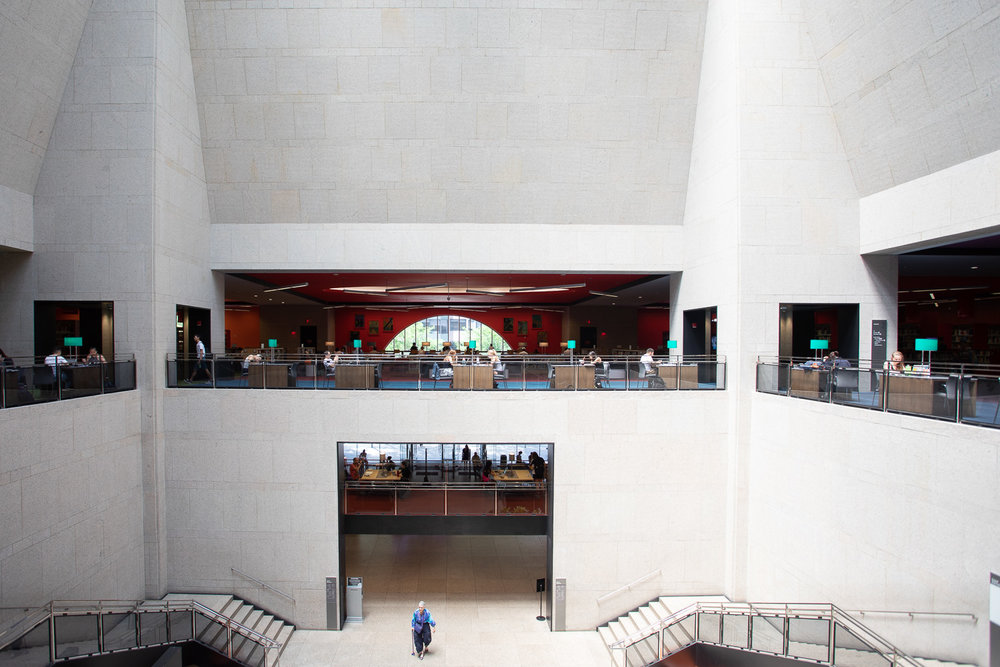 A wide interior view of the Boston Public Library from the second floor.