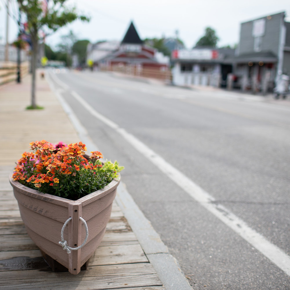 "Flowers growing inside these ship-shaped ""pots"" adorn Western Avenue (Dock Square) of Kennebunkport."