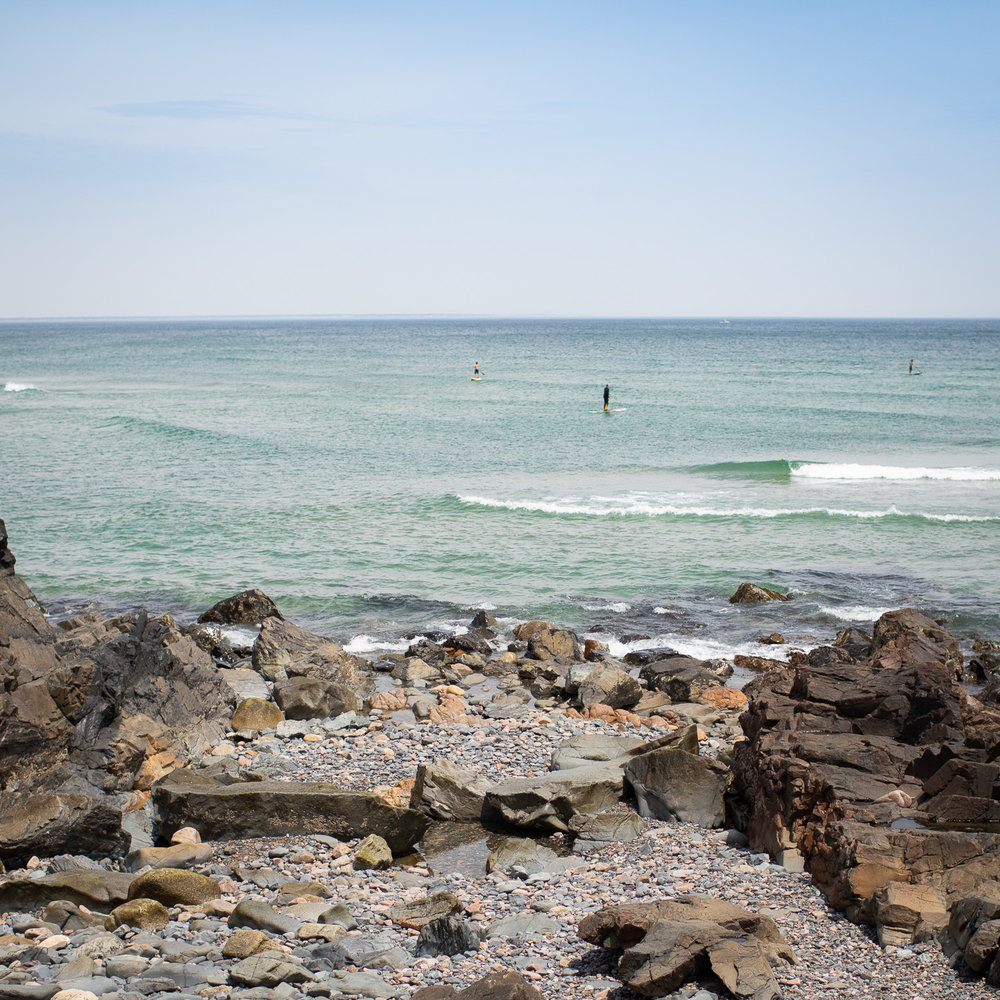 Paddleboarders enjoying the Atlantic Ocean in Ogunquit Beach.