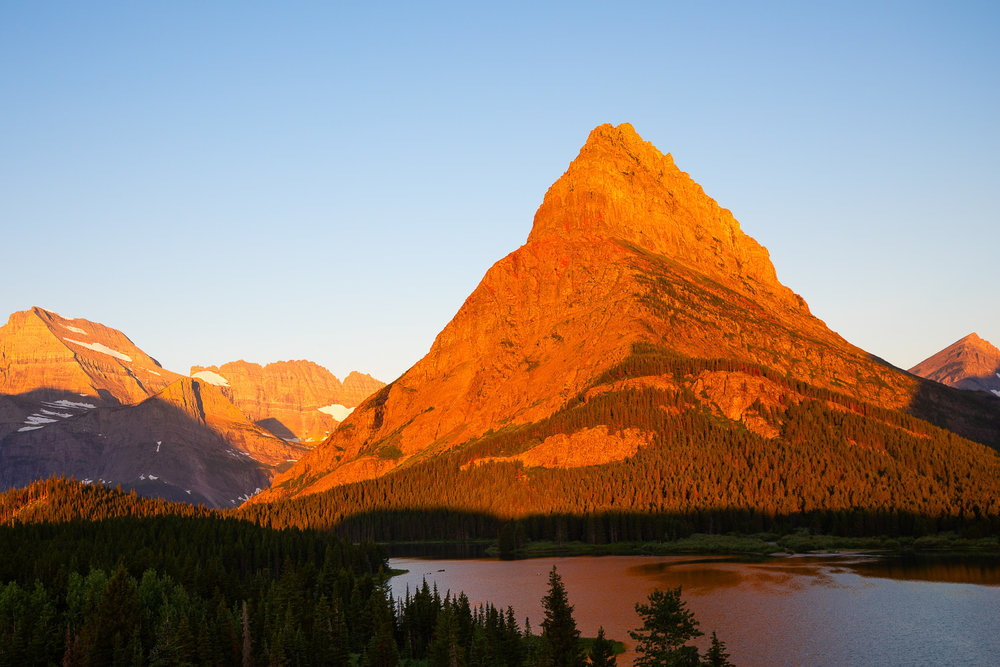 Sunrise over Grinnell Peak in Glacier National Park.