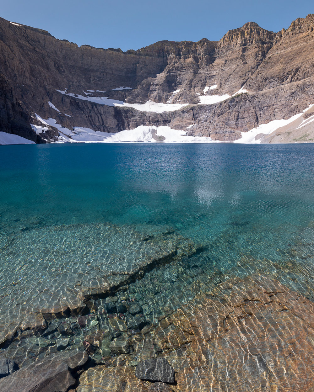A vertorama (two images stitched together) of Iceberg Lake.