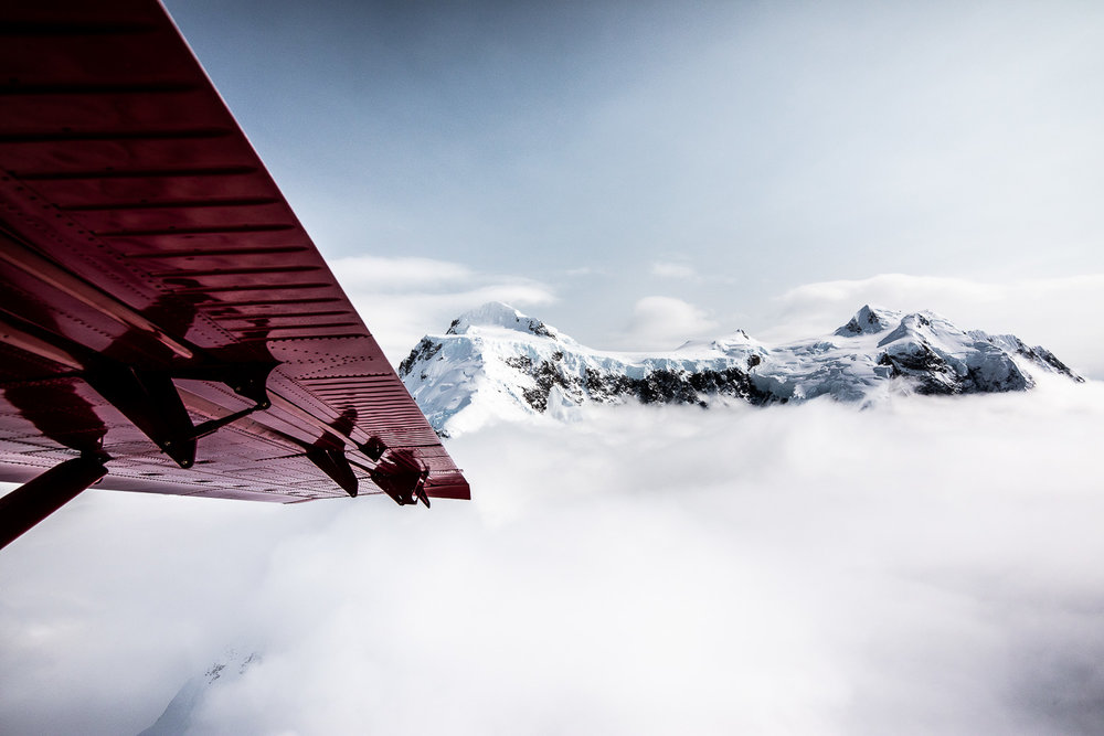 Views of the Alaska Range and the wing of the Otter.