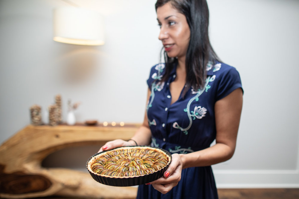 Ria serving the summer vegetable tarte (a play on ratatouille) with eggplant, zucchini, squash, roquefort, truffle, tarragon & red pepper pureé.