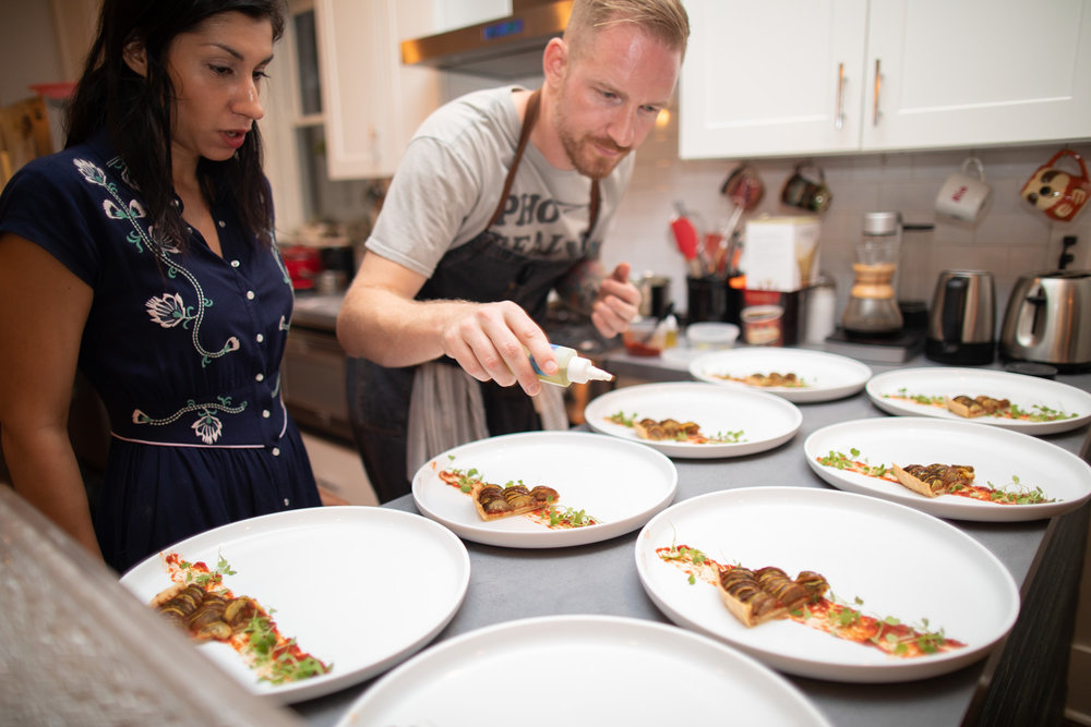 Grant and Ria plating the tarte.