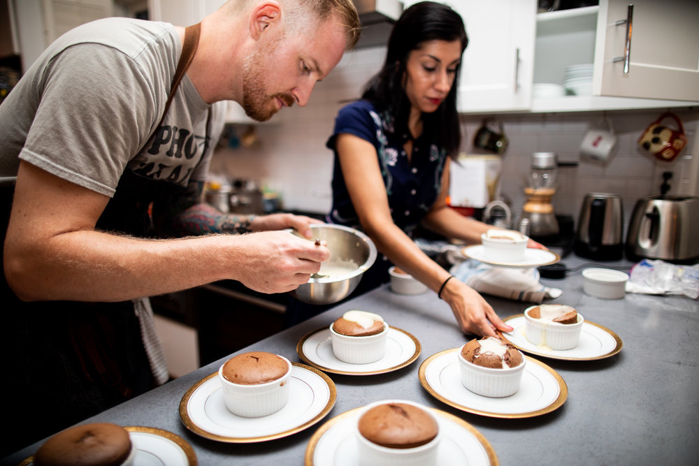 Grant and Ria putting the final touches on the chocolate soufflé.