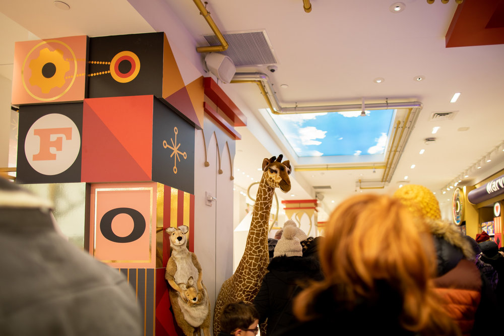 Walking into FAO Schwarz—expect plenty of crowds!