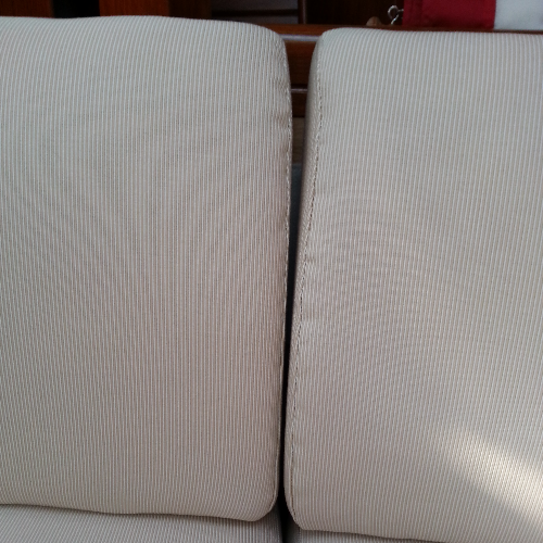 Port settee back cushions don't meet, not straight.