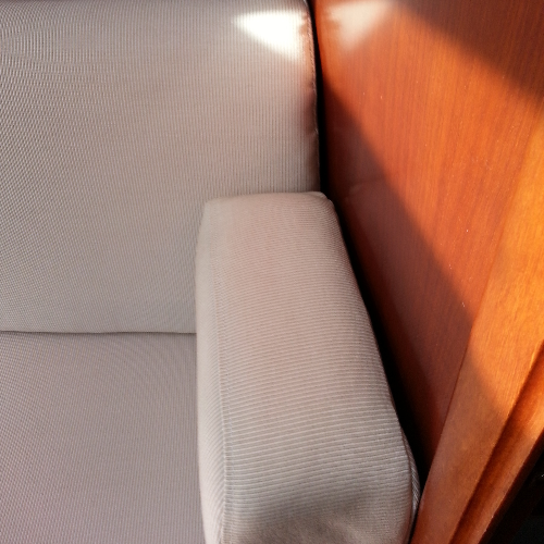Port settee arm without puckering, back flush to bulkhead.