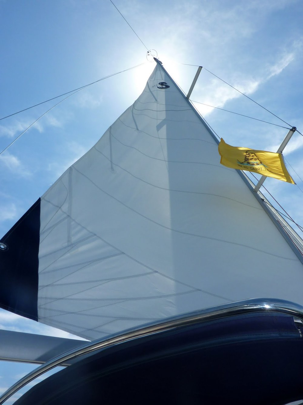 Great view of battens but not of good sail trim... (pre tea party flag - now gone - no politics allowed on CALIX)