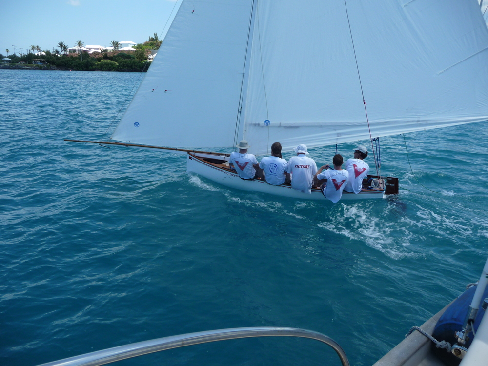 Victory IV's sailors rounding the mark boat.
