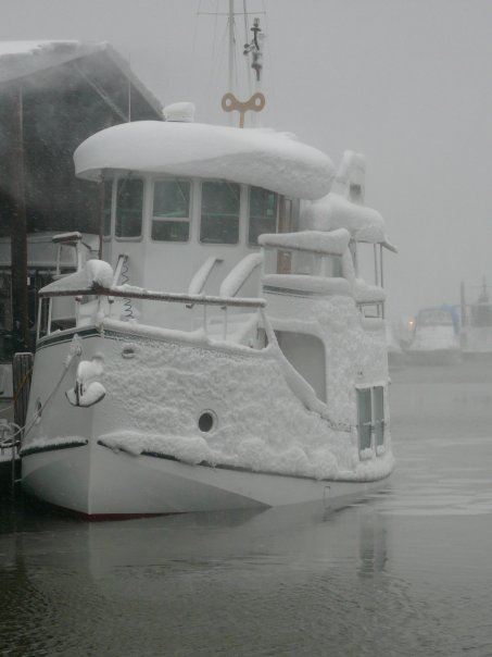 Water Lilly, a 35' Florida Bay Coasters, looks like she's going over if she gets any more wind drift snow from the covered slips roof.