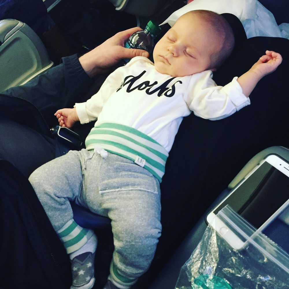 before takeoff...he passed out and was really relaxed. this was basically how he stayed for all 3 flights...except with a change of clothes.