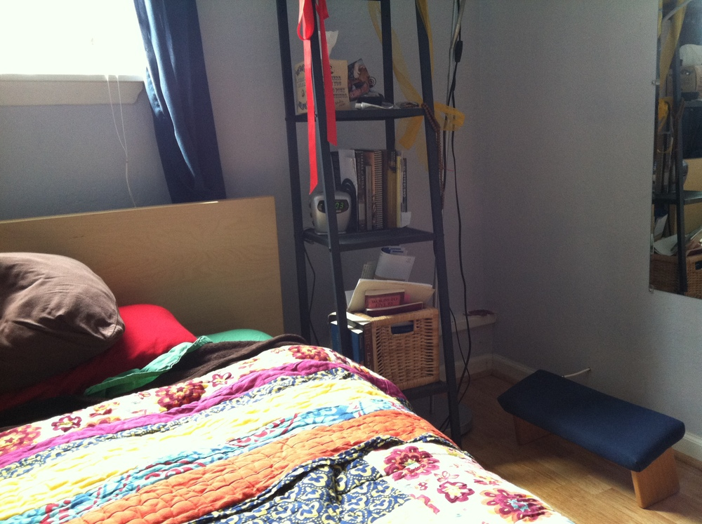 You don't need a lot of space for meditation! Lisa keeps her meditation bench just inches from her bed.