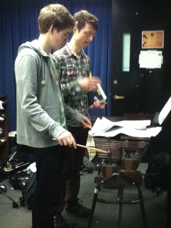 Jan (right) collaborates with a percussionist on a piece of music.