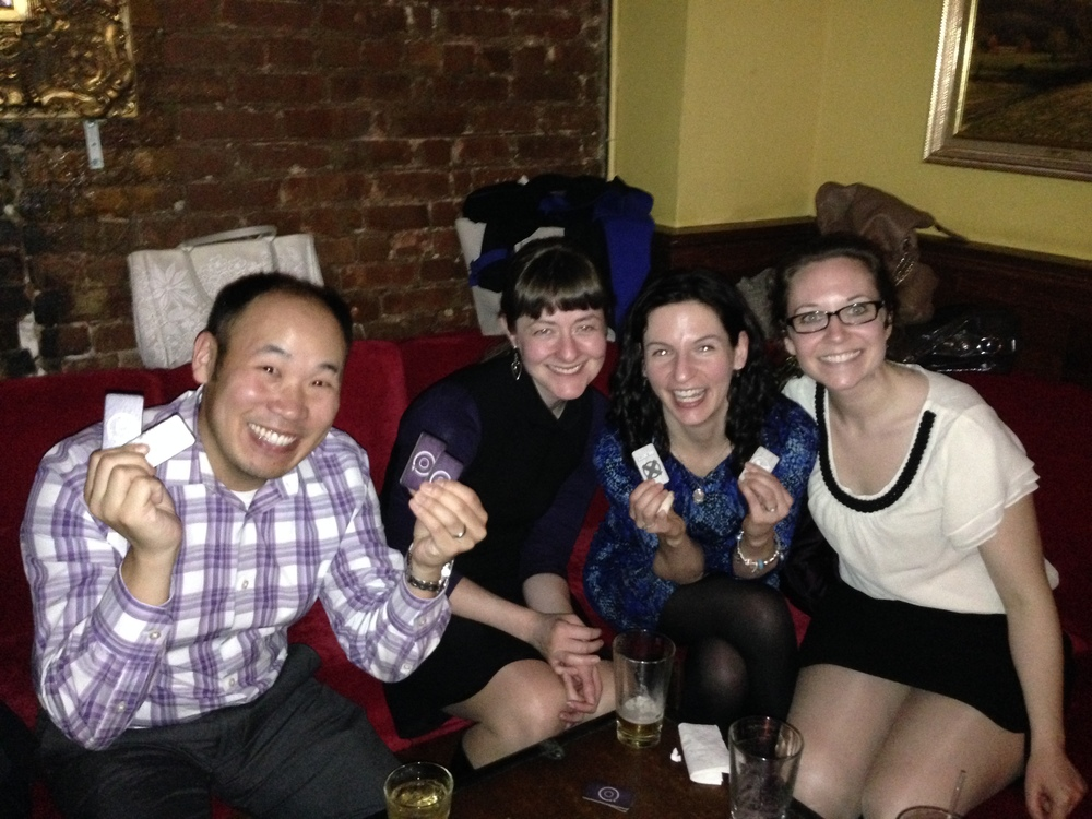 Patrick, Annie, Beth, and Laura try their poker face in a game of The Resistance. Which one's the spy??