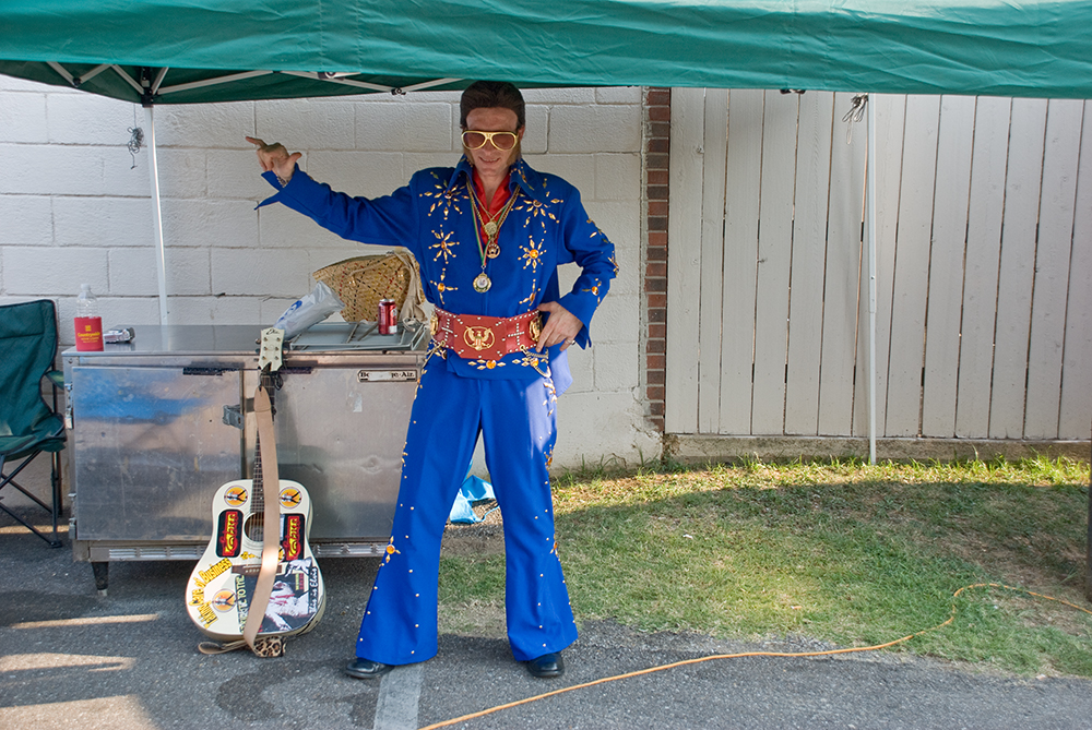You have to pass rather stringent assessments to be licensed an official Elvis Impersonator. This guy was from Italy, barely spoke English and was camped off the main drag, just down an alley by himself - singing and playing guitar.