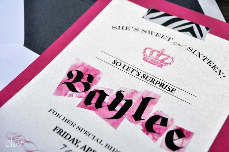 Shimmery white card on fuchsia white cards with playful mix of fonts