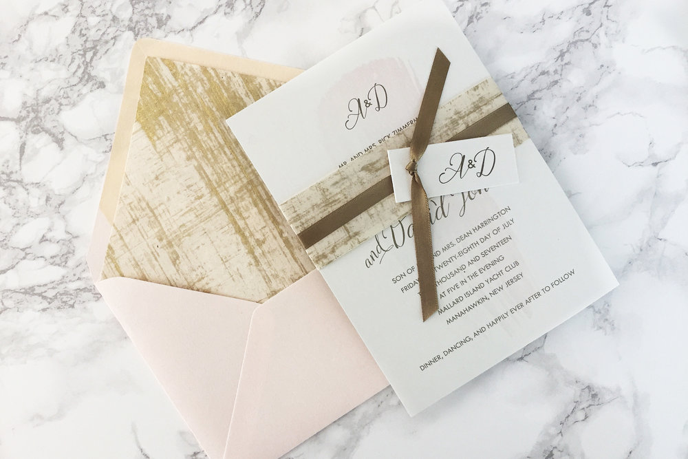 Modern gold and blush cotton wedding invitation suite with gold brushstrokes
