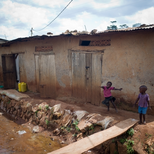 Clover children outside their homes in the slums of Busega.  Photography by Zara Tzanev